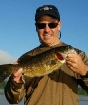 Fish NH Guide Service - client with nice largemouth bass caught in the Lakes Region of New Hampshire